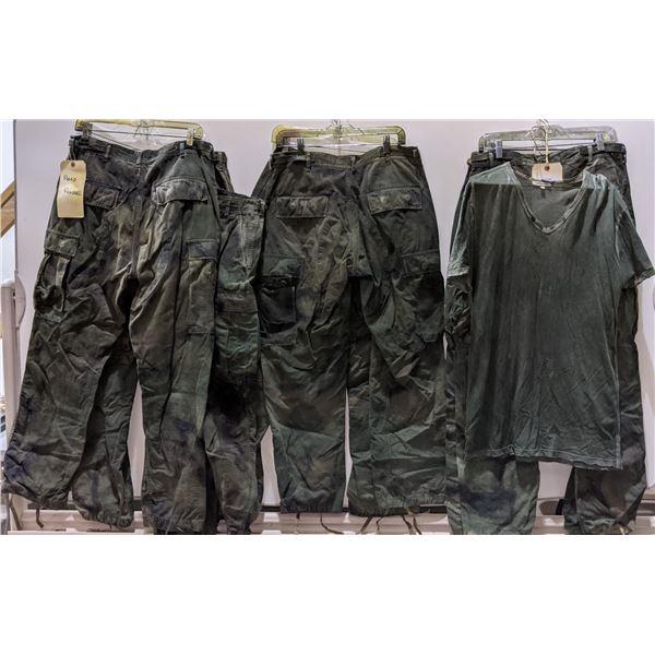 7 pairs of pants and a shirt