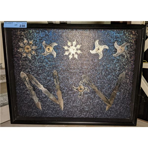 Framed throwing star and knife set display from the sci-fi show