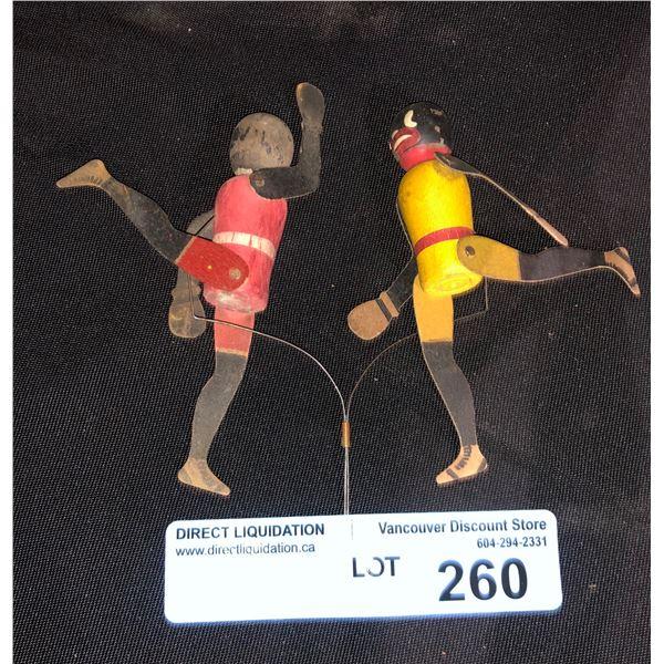 Handheld 1920s folk art toy