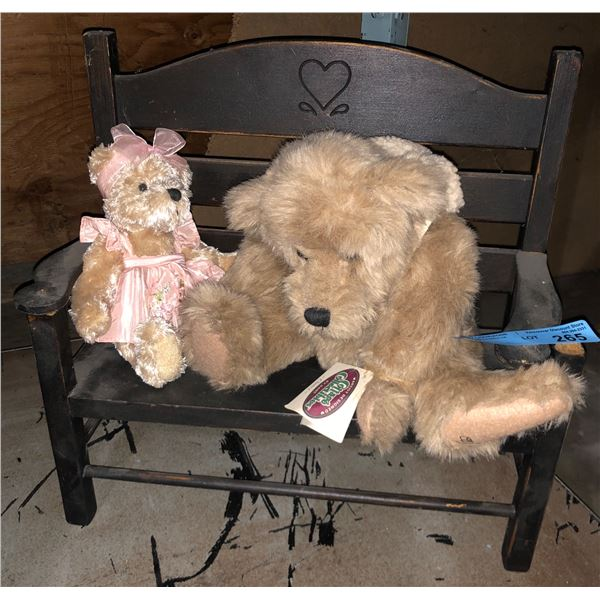Two bear toys on a bench