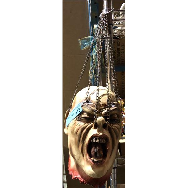 Hanging head of Gore