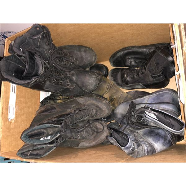 Two boxes of broken down boots from the Sci-fi show