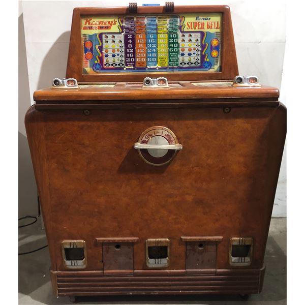 1946 Keeney's Three Way vintage slot machine on wheels