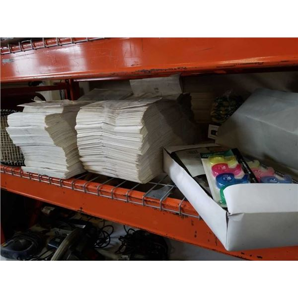 2 stacks of white paper bags and box of tape