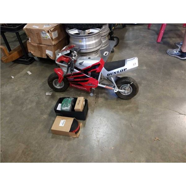 Electric pocket bike and box of new items