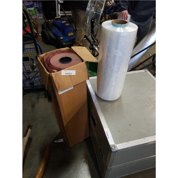 Roll of shrink wrap and roll of packing paper