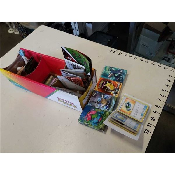 BOX OF POKEMON CARDS AND COLLECTABLE ITEMS