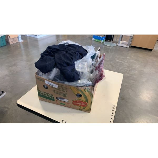 Box of new womens clothing: blouses, t-shirts, stockings and more