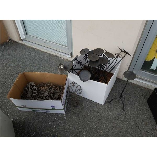 Two boxes of decorative metal candle stands and plant holders