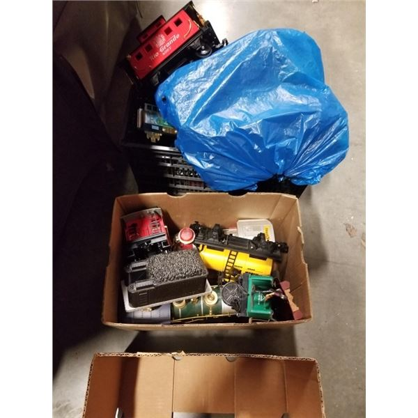 Box and crate of model trains and track