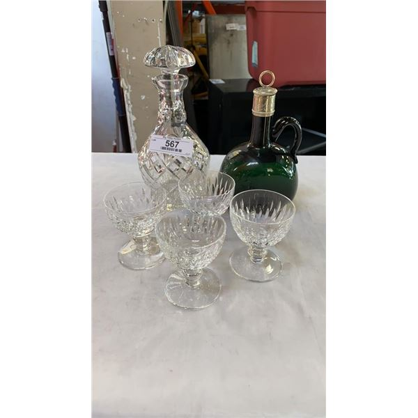 Crystal decanter with 4 waterford glasses and whiskey bottle with sterling stopper