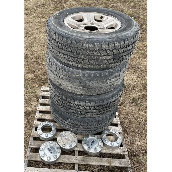 SET OF 4 P275 / 65 R18 TIRES ON ALUM FORD RIMS