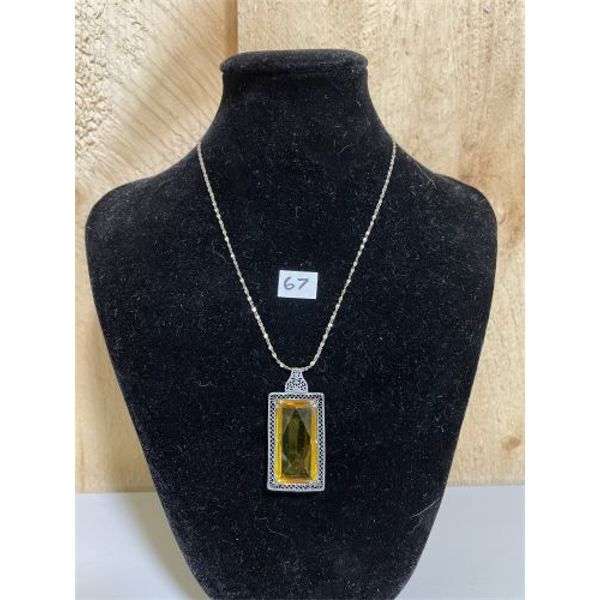 AMBER PENDANT ON A 915 SILVER CHAIN
