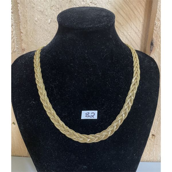 A WOVEN STRAND COSTUME JEWELRY NECKLACE