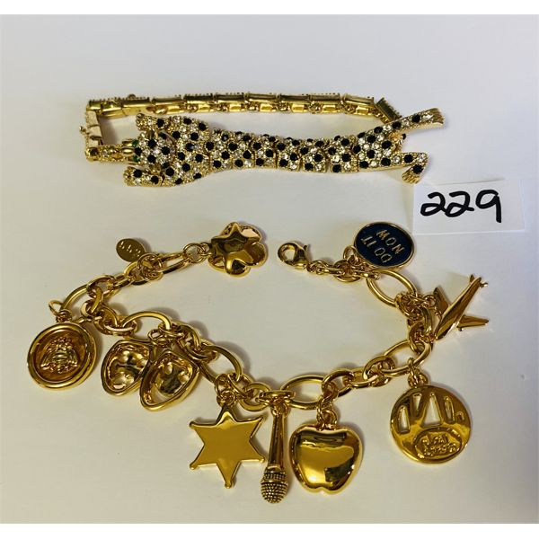 LOT OF 2 BRACELETS - RHINESTONE PANTHER & CHARMS MARKED 552
