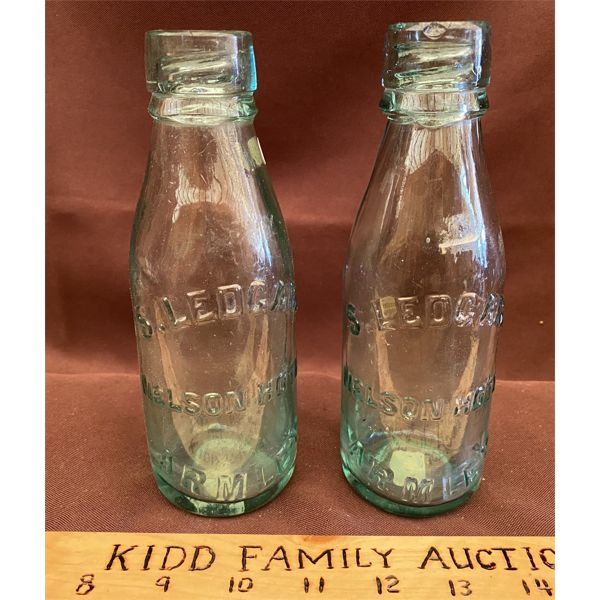 LOT OF 2 COLLECIBLE POP BOTTLES FROM THE NELSON HOTEL, ARMLEY SK