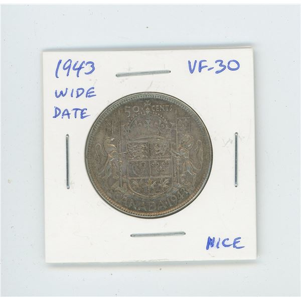 1943 Wide Date Silver 50 Cents. World War II issue. VF-30. Nice.