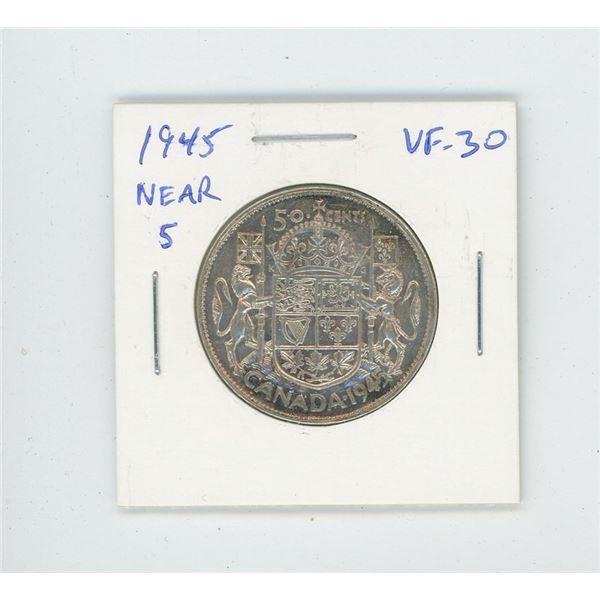 1945 Near 5 Silver 50 Cents. World War II issue. VF-30. Nice.