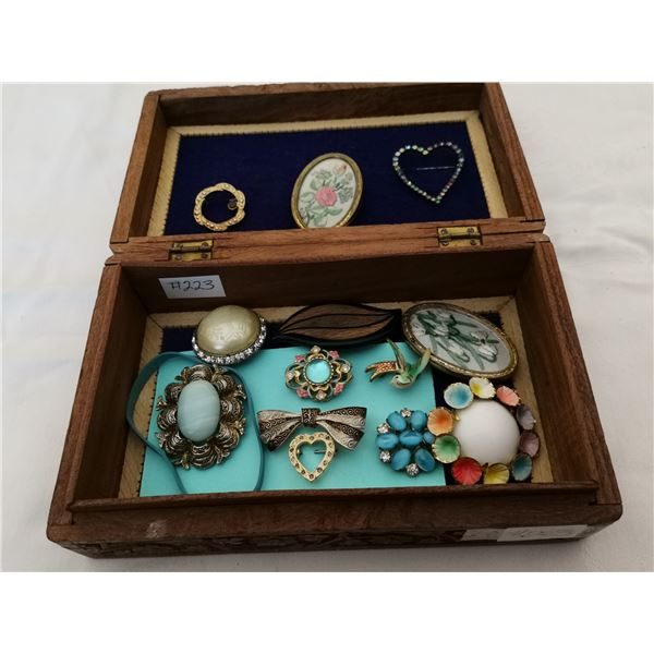 Carved box with broaches