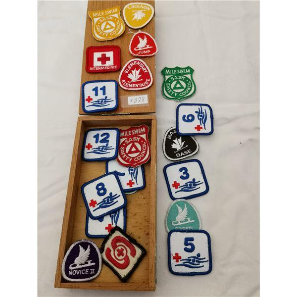 Cigar box with skating and swim badges