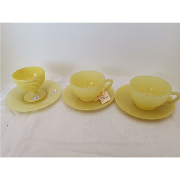 Yellow Saguenay cups and saucers (2), and one yellow sherbet with saucer