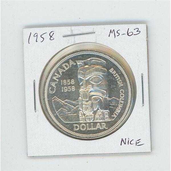1958 Silver Dollar. Coin commemorates British Columbia and depicts a totem pole. MS-63. Nice.