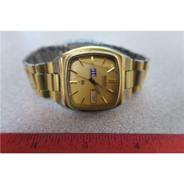SEIKO quartz watch has month & day (face is cracked)
