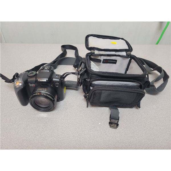 Canon Powershot SX10IS with carrying strap& case. Uses AA batteries, tested, working.