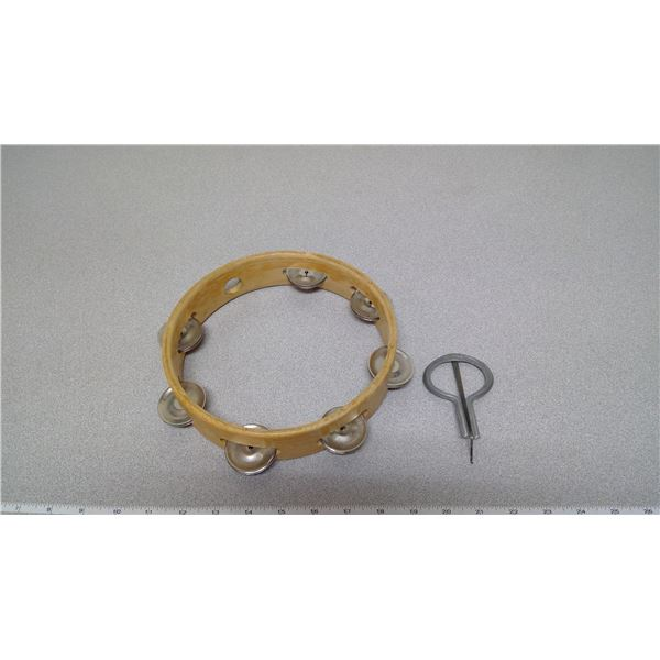 Wooden tambourine and jaw harp- (from England)