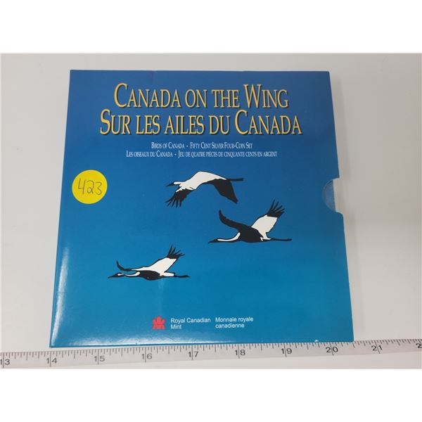 unsealed fifty cent silver four coin set (2 booklets, 2 birds each)