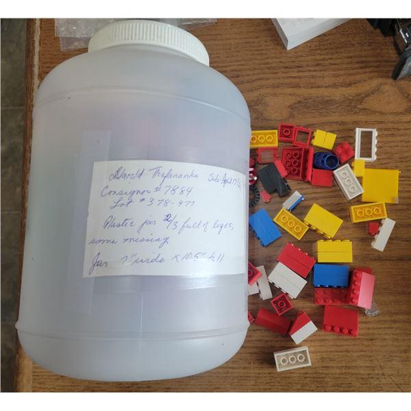 "Legos, 2/3 full container (7"" W X 10.5"" T)"