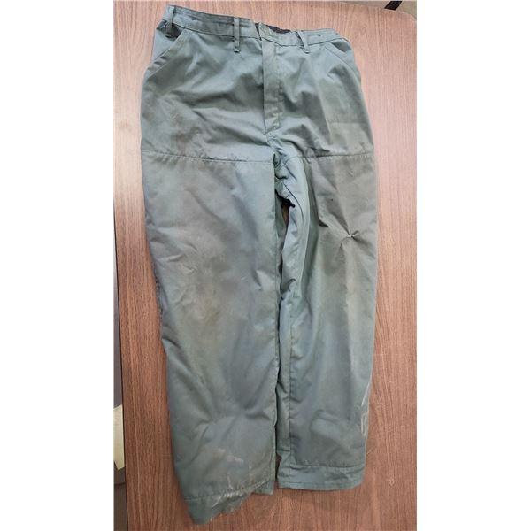 Husqvarna chain saw leg protection pants, Kevlar product, Mens size XL.