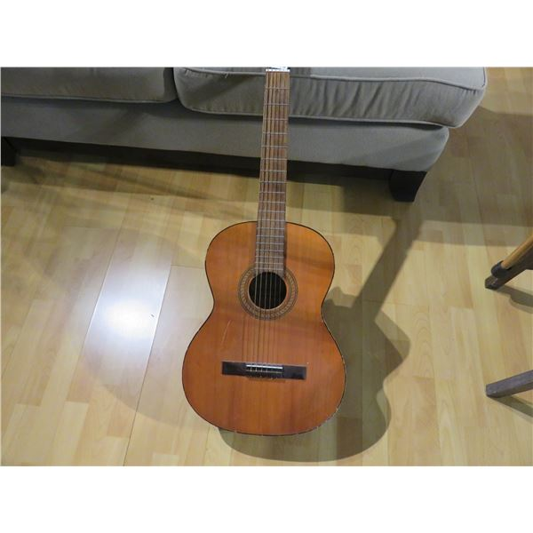 Simpson Sears guitar, probably made by Harmony, late 50's or early 60's. Good condition.
