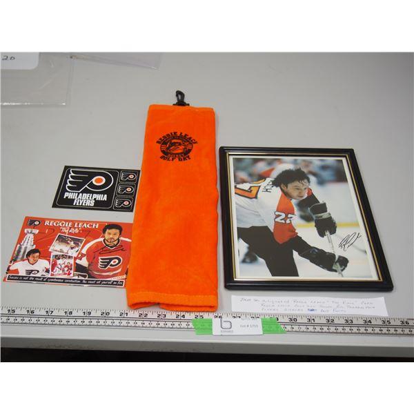 Autographed Reggie Leach The Rifle Card, Reggie Leach Gold Day Towel + Philadelphia Flyers Stickers.