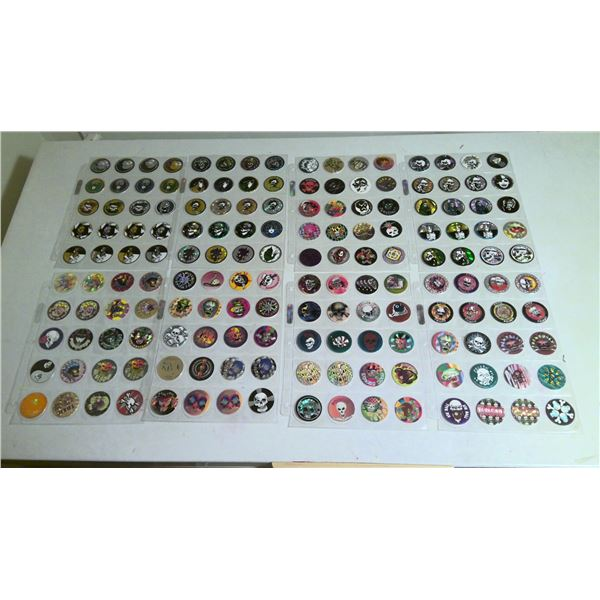 8 page lot of 1990s Pogs