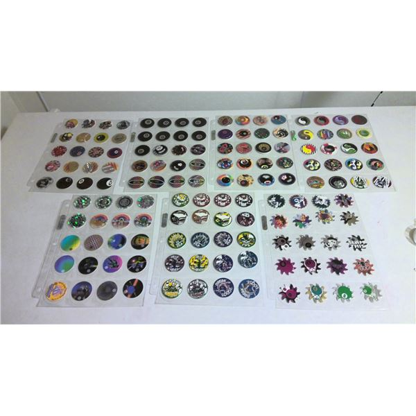 7+ page lot of 1990s Pogs