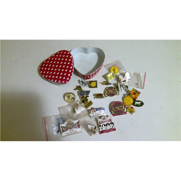 Lot of collectible lapel pins in heart tin