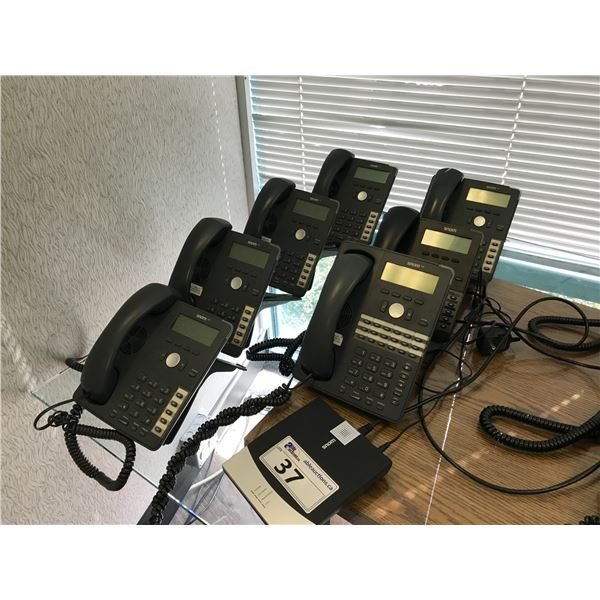 LOT OF 7 SNOM 7 SERIES VOIP PHONE HAND SETS AND ONE SNOM GATEWAY