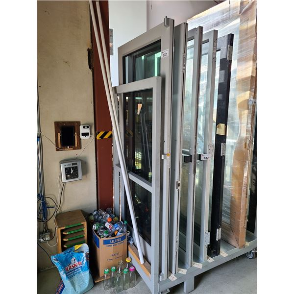 "PAIR OF ALUMINUM FRAME AND GLASS COMMERCIAL DOUBLE DOORS 35"" X 83.5"""