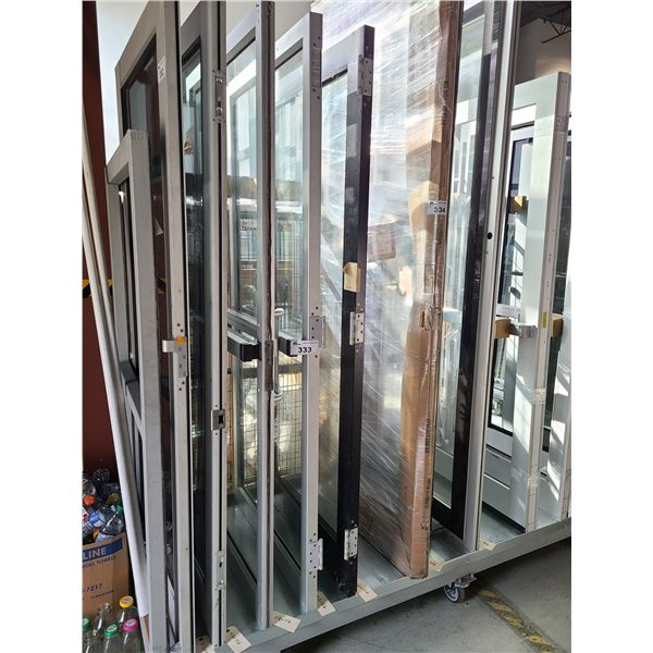 PAIR OF ALUMINUM FRAME AND GLASS COMMERCIAL PUSH PULL DOUBLE DOORS 35  X 83