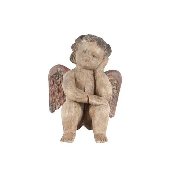 Hand-Carved Seated Cherub Figure