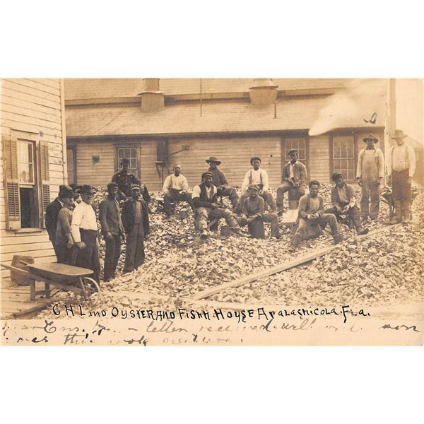Apalachicola, Florida Oyster & Fish House with African American on shells Real Photo Postcard