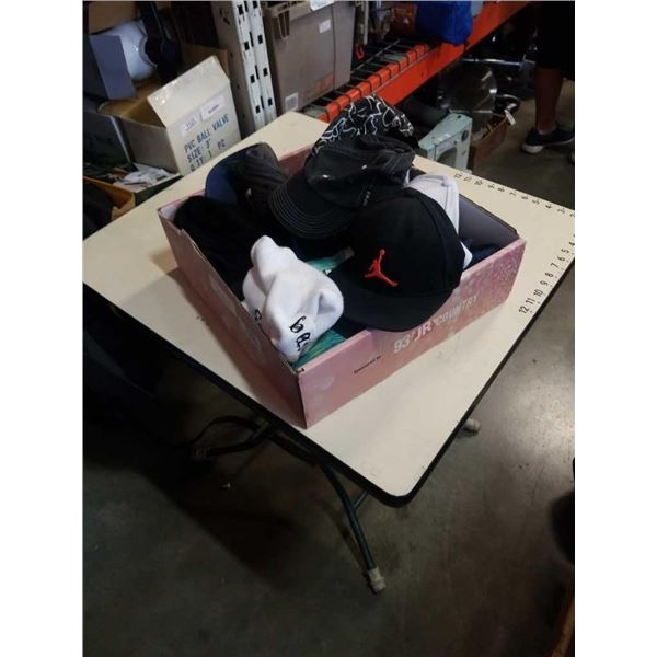 Box of cleveland indians, air jordan and other hats
