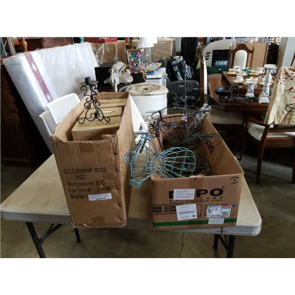 Two boxes of decorative metal candle holders, mini dress forms and more