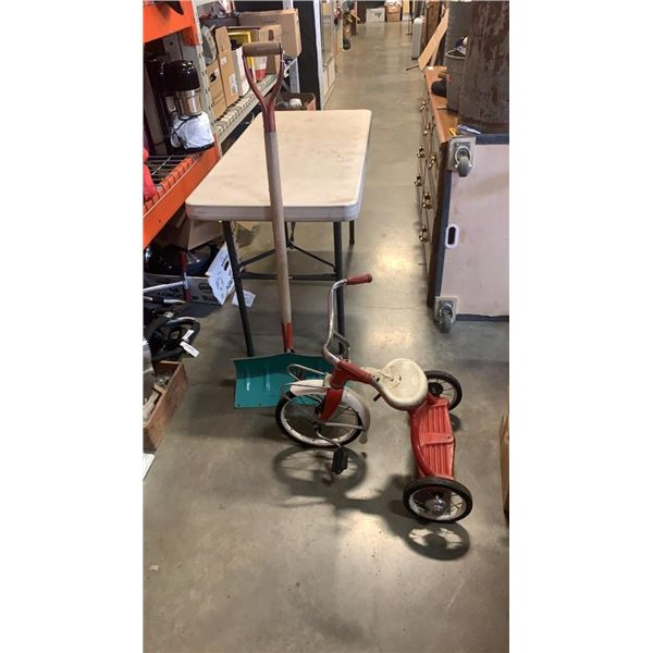 Troxel tricycle and metal snow shovel