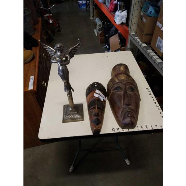 Metal angel stand and 2 carved masks