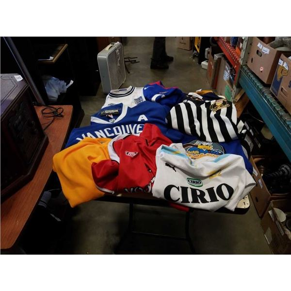 LOT OF SPORTS JERSEYS, INCLUDES CANUCKS AND DONALD DUCK