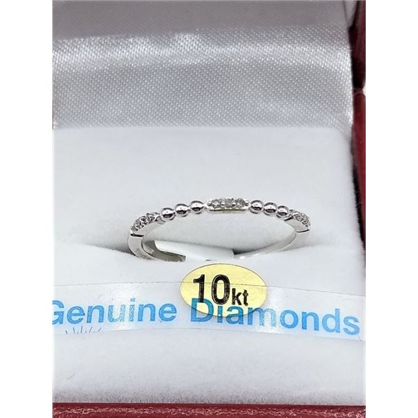 10KT WHITE GOLD DIAMOND RING, 9 DIAMONDS .6CTS W/ APPRAISAL $1315