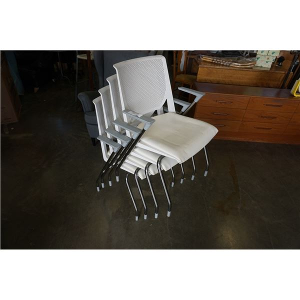 4 WHITE STACKING CHAIRS