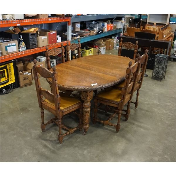 ANTIQUE CARVED OAK CRANK DINING TABLE WITH 2 LEAFS AND 6 CHAIRS